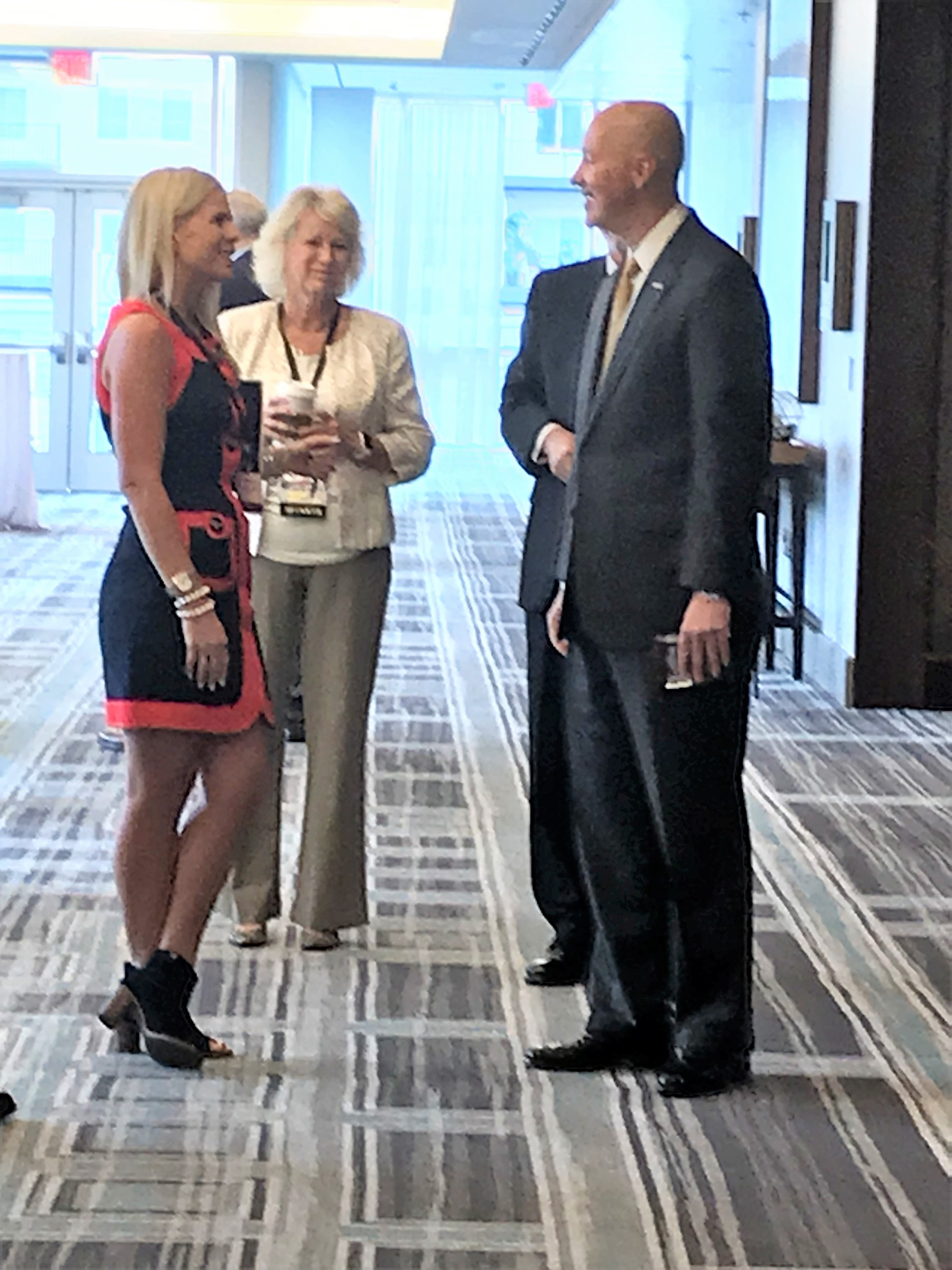Encore's Kim Herzog meeting Nebraska Governor Pete Ricketts at ACE Conference